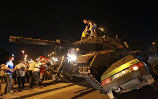 A tank crashes a car as people take streets in Ankara, Turkey during a protest agaist military coup on July 16, 2016. 42 dead in Ankara coup attempt clashes: TV citing prosecutor. Turkish military forces on July 16 opened fire on crowds gathered in Istanbul following a coup attempt, causing casualties, an AFP photographer said. The soldiers opened fire on grounds around the first bridge across the Bosphorus dividing Europe and Asia, said the photographer, who saw wounded people being taken to ambulances.  / AFP / ADEM ALTAN        (Photo credit should read ADEM ALTAN/AFP/Getty Images)