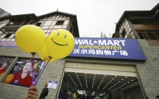 全中国的沃尔玛雇员针对该公司的新工时制度发起了一系列罢工,这是一波史无前例的全国性罢工。 (China Photos/Getty Images)