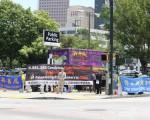 亞特蘭大法輪功學員7-20舉行集会,反對迫害,谴责中共暴行。(岳雷/大紀元)