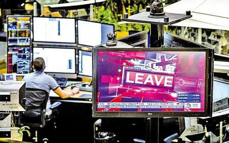 標普同時警告,英國「脫歐」仍是風險,但整體而言亞太區國家主權評級趨勢仍然穩定。(AFP)