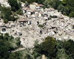 "A hand out picture taken by the Guardia di Finanza press office on August 24, 2016 and released on August 25, 2016 shows an aerial view of the vilage of Pescara del Tronto in central Italy after a strong eartquake that claimed at least 247 lives. Central Italy was struck by a powerful, 6.2-magnitude earthquake in the early hours of August 24, that shook central Italy and the death toll rose to 247 on August 25, as rescuers desperately searched for survivors in the rubble of devastated mountain villages. Hundreds of others were injured, some critically, and an unknown number were trapped under the ruins of collapsed buildings after Wednesday's pre-dawn quake. / AFP PHOTO / Guardia di Finanza press office / HO / RESTRICTED TO EDITORIAL USE - MANDATORY CREDIT ""AFP PHOTO / GUARDIA DI FINANZA PRESS OFFICE"" - NO MARKETING NO ADVERTISING CAMPAIGNS - DISTRIBUTED AS A SERVICE TO CLIENTS"