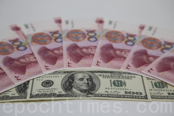 人民幣兌美元一度跌至7.48 北京蓄意為之?