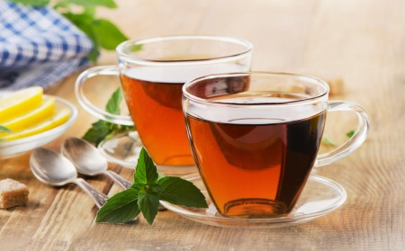 Cups of tea with mint leaves.