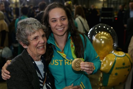 SYDNEY, AUSTRALIA - AUGUST 24: Chloe Dalton is greeted by family members during the Welcome Home for Australian Olympic Games athletes at Sydney International Airport on August 24, 2016 in Sydney, Australia. (Photo by Jason McCawley/Getty Images)
