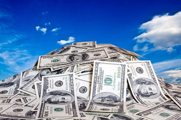 对于美国整体而言,要想进入全美家庭收入最高的1%群组,税前年收入至少要389,436美元。 (Fotolia)