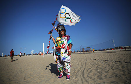 RIO DE JANEIRO, BRAZIL - AUGUST 04: Olympic tourist Vivianne Robinson, from California, poses before viewing her sixth Olympics ahead of the arrival of the Olympic torch relay in Copacabana on August 4, 2016 in Rio de Janeiro, Brazil. The Rio 2016 Olympic Games commence on August 5. (Photo by Mario Tama/Getty Images)