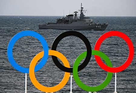 A boat of the Navy of Brazil is pictured with the Olympic Rings in the foreground as she patrols the coast of Copacabana beach, in Rio de Janeiro, on August 4, 2016, ahead of the Rio 2016 Olympic Games. / AFP / LUIS ACOSTA (Photo credit should read LUIS ACOSTA/AFP/Getty Images)