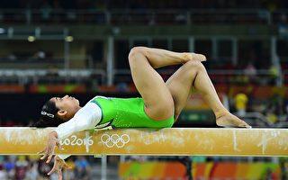 體操選手迪帕·卡瑪卡爾成爲印度首位獲得奧運體操決賽資格的運動員,圖為她在里約奧運平衡木預賽中。(EMMANUEL DUNAND/AFP/Getty Images)