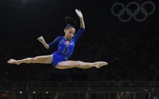 中國體操運動員商春松在里約奧運會僅獲得女子全能第四。(BEN STANSALL/AFP/Getty Images)