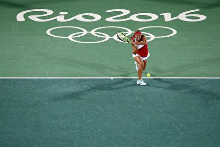里约奥运网球赛结束了女单冠军的争夺,世界排名34位的波多黎各选手普伊格夺得金牌。(Dean Mouhtaropoulos/Getty Images)