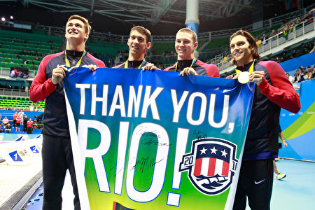 RIO DE JANEIRO, BRAZIL - AUGUST 13: Gold medalists Nathan Adrian, Michael Phelps, Ryan Murphy and Cody Miller of the United States thank the crowd during the medal ceremony for the Men's 4 x 100m Medley Relay Final on Day 8 of the Rio 2016 Olympic Games at the Olympic Aquatics Stadium on August 13, 2016 in Rio de Janeiro, Brazil. (Photo by Adam Pretty/Getty Images)