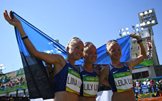 Estonia's Liina Luik, Estonia's Lily Luik and Estonia's Leila Luik pose after crossing the finish line of the Women's Marathon during the athletics event at the Rio 2016 Olympic Games at Sambodromo in Rio de Janeiro on August 14, 2016.   / AFP / POOL / Johannes EISELE        (Photo credit should read JOHANNES EISELE/AFP/Getty Images)