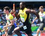 牙买加志在卫冕男子4x100米接力冠军。图为8月18日,牙买加队参加男子4x100米接力预赛。(FRANCK FIFE/AFP/Getty Images)