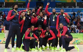 Gold medallists USA's forward Jimmy Butler, USA's guard Kevin Durant, USA's centre DeAndre Jordan, USA's guard Kyle Lowry, USA's forward Harrison Barnes, USA's guard Demar Derozan, USA's guard Kyrie Irving, USA's guard Klay Thompson, USA's centre DeMarcus Cousins, USA's guard Paul George, USA's forward Draymond Green and USA's forward Carmelo Anthony pose after the final of the Men's basketball competition at the Carioca Arena 1 in Rio de Janeiro on August 21, 2016 during the Rio 2016 Olympic Games. / AFP / Mark RALSTON        (Photo credit should read MARK RALSTON/AFP/Getty Images)