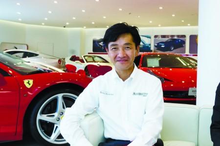 法拉利正规专卖店Rosso Scuderia 销售部负责人吉村谦一。(游沛然/大纪元)