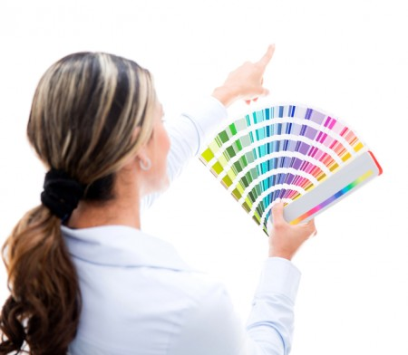 Woman choosing a color for the wall
