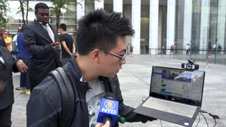 法拉盛果粉向中国大陆网民直播纽约发售新iPhone的盛况。