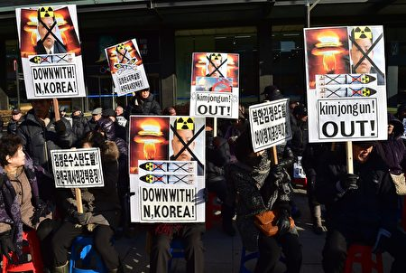 "South Korean conservative activists hold placards showing portraits of North Korean leader Kim Jong-Un during a rally denouncing North Korea's hydrogen bomb test, in Seoul on January 7, 2016. The US and South Korean presidents vowed on January 7 to impose the ""most powerful and comprehensive"" sanctions on North Korea after its globally condemned fourth nuclear test. AFP PHOTO / JUNG YEON-JE / AFP / JUNG YEON-JE (Photo credit should read JUNG YEON-JE/AFP/Getty Images)"