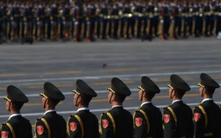 Chinese honour guards wait to perform during a military parade at Tiananmen Square in Beijing on September 3, 2015, to mark the 70th anniversary of victory over Japan and the end of World War II. A huge military parade rolls through Tiananmen Square as Beijing commemorates the 70th anniversary of Japan's WWII defeat, but major Western leaders are staying away from the show of strength. AFP PHOTO / GREG BAKER        (Photo credit should read GREG BAKER/AFP/Getty Images)