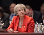 """英国情报机构警告那些跟随首相梅伊前往中国杭州参加G20峰会的官员,避免掉进中共美女间谍的""""甜蜜陷阱""""中。(Nicolas Asfouri - Pool/Getty Images)"""