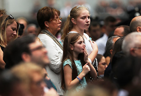 NEW YORK, NY - SEPTEMBER 11: A child pauses during a commemoration ceremony for the victims of the September 11 terrorist attacks at the National September 11 Memorial and Museum fifteen years after the day on September 11, 2016 in New York City. Throughout the country services are being held to remember the 2,977 people who were killed in New York, the Pentagon and in a field in rural Pennsylvania. (Photo by Spencer Platt/Getty Images)