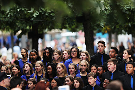 NEW YORK, NY - SEPTEMBER 11: A choir sings as family members, emergency workers and others attend commemoration ceremony for the victims of the September 11 terrorist attacks at the National September 11 Memorial and Museum fifteen years after the day on September 11, 2016 in New York City. Throughout the country services are being held to remember the 2,977 people who were killed in New York, the Pentagon and in a field in rural Pennsylvania. (Photo by Spencer Platt/Getty Images)