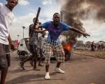 9月19日,刚果(金)首都金沙萨发生举行大规模骚乱,示威者与警方发生冲突,造成至少17人死亡。(AFP/Getty Images)