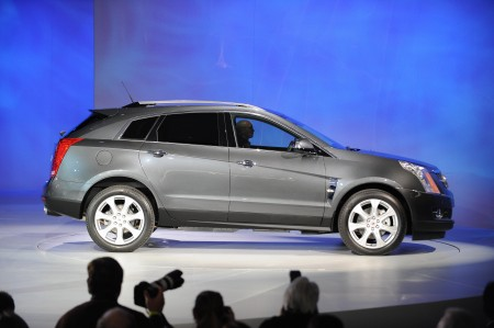 The Cadillac SRX rolls out during a press preview at the North American International Auto Show January 11, 2009 in Detroit, Michigan. AFP PHOTO/Stan HONDAWith sales tanking and General Motors and Chrysler struggling for their very survival, the Detroit auto show promises to be a subdued and tense affair as automakers launch new models to compete for an ever-dwindling number of customers. Some 58 new models -- including 44 worldwide debuts -- will be introduced in the coming days as the manufacturers vie for the attention of nearly 7,000 journalists from over 60 countries at press previews. AFP PHOTO/Stan HONDA (Photo credit should read STAN HONDA/AFP/Getty Images)