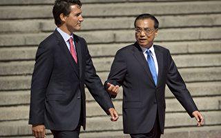 加拿大总理特鲁多8月31日与中共总理李克强在北京会谈。(加通社)