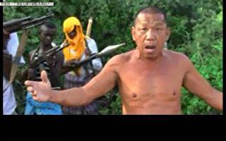 阿曼籍漁船「Naham 3號」2012年3月遭索馬利亞海盜挾持,倖存26名人質10月23日傳出獲釋,其中台灣籍輪機長沈瑞章(圖)在遭押2年10個月後曾透過影片訴說處境。(蔡正元提供)