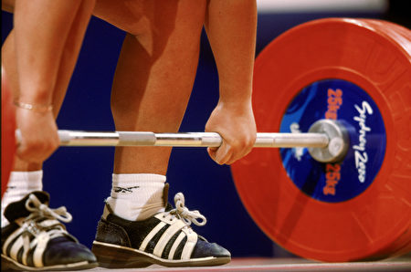 SYDNEY - SEPTEMBER 22: A general view of a lifter during the Women's 75+kg weight lifting finals at the Sydney Convention Centre during the Sydney Olympic Games in Sydney, Australia on September 22, 2000. (Photo by Doug Pensinger /Getty Images)
