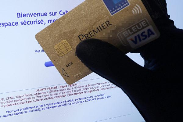 澳大利亞當局發現海外犯罪團伙建立虛假網站,以詐騙消費者和盜竊信用卡細節。澳大利亞互聯網址管理機構已經關閉1000多家網站。   (VALERY HACHE/AFP/Getty Images)