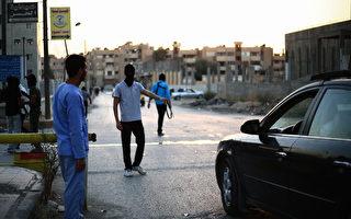 """美国国防部长卡特周三透露,为了彻底打击伊斯兰国(IS),进攻IS所谓""""首都""""拉卡的战役将在几个星期内展开。 图为拉卡。(MEZAR MATAR/AFP/Getty Images)"""