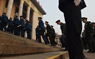Military delegates walk up the steps of the Great Hall of the People to attend the closing session of the National People's Congress in Beijing on March 16, 2016.   The annual meeting of China's rubber-stamp National People's Congress closed on March 16 after a 12-day session. / AFP / GREG BAKER        (Photo credit should read GREG BAKER/AFP/Getty Images)