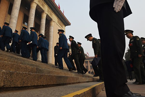 Military delegates walk up the steps of the Great Hall of the People to attend the closing session of the National People's Congress in Beijing on March 16, 2016.The annual meeting of China's rubber-stamp National People's Congress closed on March 16 after a 12-day session. / AFP / GREG BAKER (Photo credit should read GREG BAKER/AFP/Getty Images)