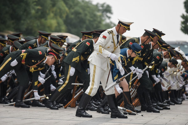 BEIJING, CHINA - SEPTEMBER 13: Honour guards pick up their weapon before the welcoming ceremony of Peruvian President outside the Great Hall of the People on September 13, 2016 in Beijing, China. (Photo by Etienne Oliveau/Getty Images)