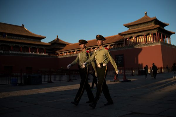 TOPSHOT - Chinese paramilitary soldiers walk outside the gate of the Forbidden City in Beijing on September 28, 2016. / AFP / NICOLAS ASFOURI (Photo credit should read NICOLAS ASFOURI/AFP/Getty Images)
