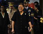 泰国总理帕拉育周二(18日)表示,王储瓦吉拉隆功最快可以在周五(21日)继承王位,此意味着泰国人民期盼诗琳通公主继位的愿望已无法实现。图为诗琳通公主17日出席UNFAO会议。(LILLIAN SUWANRUMPHA/AFP/Getty Images)