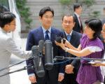 三星王國實際掌權的李在鎔(中)如在Note 7危機因應得宜,有可能在月底舉行的董事會中接班。(JUNG YEON-JE/AFP/Getty Images)