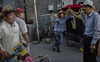 北京方言在消失。它是语言标准化、城市发展和移民的牺牲品。(Kevin Frayer/Getty Images)