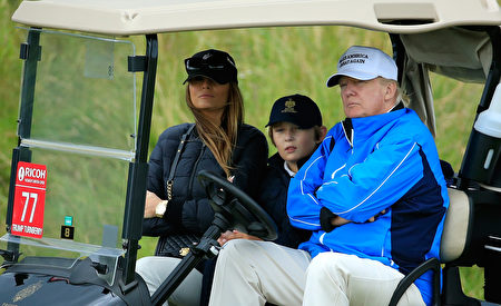 TURNBERRY, SCOTLAND - AUGUST 01: Donald Trump watches the action with wife Melania and son Barron during the Third Round of the Ricoh Women's British Open at Turnberry Golf Club on August 1, 2015 in Turnberry, Scotland. (Photo by David Cannon/Getty Images)