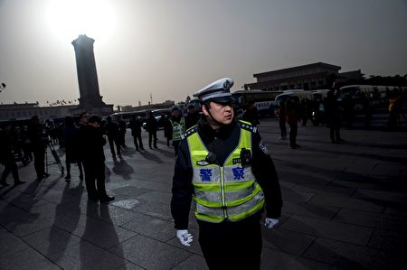 A policeman stands at the Great Hall of the People during the opening ceremony of the National People's Congress in Beijing on March 5, 2016. Chinas Communist-controlled parliament opened its annual session on March 5 and is expected to approve a new five-year plan to tackle slowing growth in the worlds second-largest economy. / AFP / FRED DUFOUR (Photo credit should read FRED DUFOUR/AFP/Getty Images)