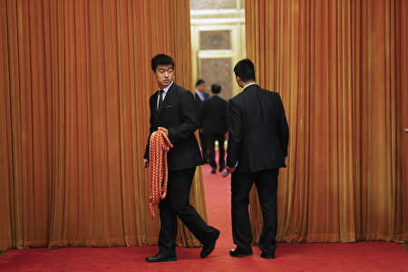 BEIJING, CHINA - APRIL 28: A security agent holds a rope outside a room where China's President Xi Jinping meets Russian Foreign Minister Sergey Lavrov at the Great Hall of the People on April 28, 2016 in Beijing, China. (Photo by Damir Sagolj - Pool/Getty Images)