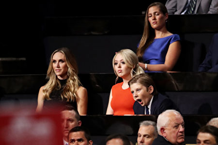 CLEVELAND, OH - JULY 21: Lara Yunaska, Tiffany Trump and Barron Trump listen to Ivanka Trump speak during the evening session on the fourth day of the Republican National Convention on July 21, 2016 at the Quicken Loans Arena in Cleveland, Ohio. Republican presidential candidate Donald Trump received the number of votes needed to secure the party's nomination. An estimated 50,000 people are expected in Cleveland, including hundreds of protesters and members of the media. The four-day Republican National Convention kicked off on July 18. (Photo by Win McNamee/Getty Images)