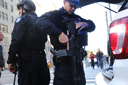 NEW YORK, NY - NOVEMBER 08: Counterterrorism police patrol near Trump Tower on Election Day on November 8, 2016 in New York City. Throughout the country, millions of Americans are casting their votes today for either Hillary Clinton or Donald Trump to become the 45th president of the United States. (Photo by Spencer Platt/Getty Images)