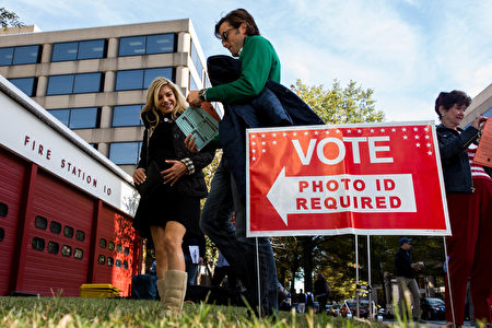 ARLINGTON, VA - NOVEMBER 08: People make their way into Fire Station 10 to vote in the 2016 election on November 8, 2016 in Arlington, Virginia. Americans across the nation are picking their choice for the next president of the United States. (Photo by Zach Gibson/Getty Images)