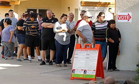 PHOENIX, AZ - NOVEMBER 08: Voters wait in line at the Maryvale Church of the Nazarene polling place to cast their vote on November 8, 2016 in Phoenix, Arizona. Americans across the nation are picking their choice for the next president of the United States. (Photo by Ralph Freso/Getty Images)