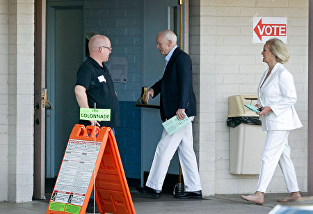 PHOENIX, AZ - NOVEMBER 08: Sen. John McCain (R-AZ), center, and his wife Cindy arrive at the Mountain View Christian Church polling place to cast their vote on November 8, 2016 in Phoenix, Arizona. Throughout the country, millions of Americans are casting their votes today for either Hillary Clinton or Donald Trump to become the 45th president of the United States. (Photo by Ralph Freso/Getty Images)