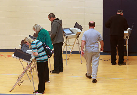 PROVO, UT - NOVEMBER 08: People cast their ballot in the presidential election at Freedom Academy elementary school on November 8, 2016 in Provo, Utah. Americans across the nation are picking their choice for the next president of the United States. (Photo by George Frey/Getty Images)