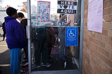 Voters wait in line at a polling station in Philadelphia, Pennsylvania, on election day November 8, 2016. America's future hung in the balance Tuesday as millions of eager voters cast ballots to elect Democrat Hillary Clinton as their first woman president, or hand power to the billionaire populist Donald Trump. As the world held its collective breath, Americans were called to make a historic choice between two radically different visions for the most powerful nation on Earth. / AFP / DOMINICK REUTER (Photo credit should read DOMINICK REUTER/AFP/Getty Images)
